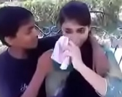 Indian teen kissing with an increment of pressing interior in public
